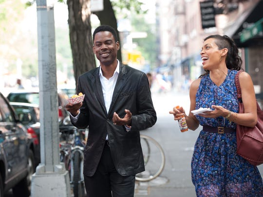 """This image released by Paramount Pictures shows Chris Rock, left, and Rosario Dawson in a scene from """"Top Five."""" (AP Photo/Paramount Pictures, Ali Paige Goldstein)"""