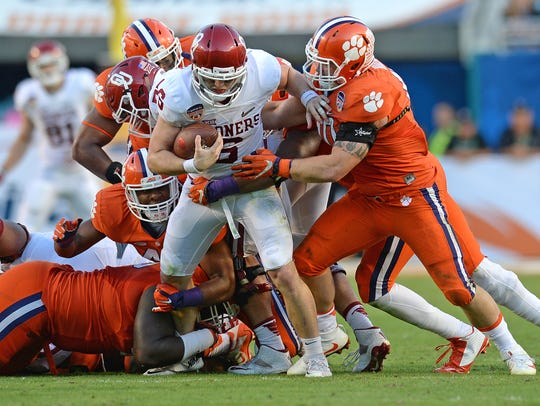 Oklahoma quarterback Baker Mayfield (6) is sacked by