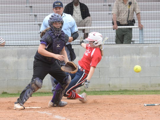 Emma Callie Delafield slides into home plate as catcher