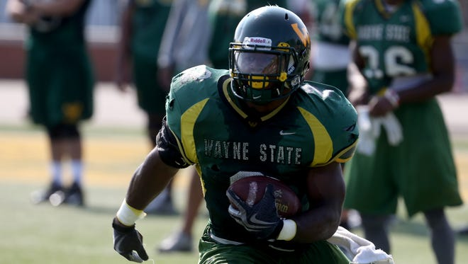 Wayne State running back Desmond Martin runs a play during practice at Adams Field on Aug. 21, 2014.