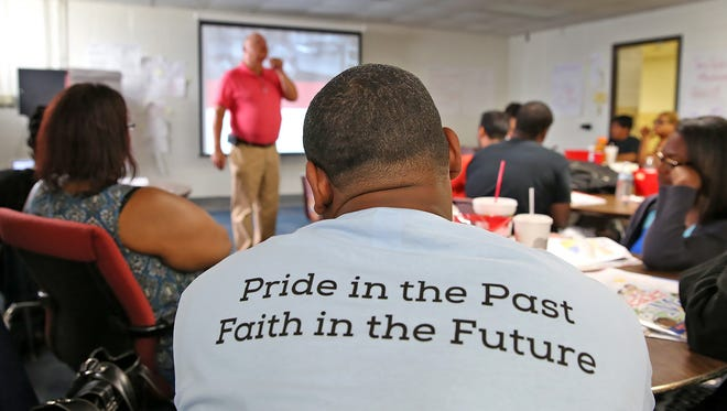 Teachers learn about the new positive culture they will teach at the Kindezi Academy at Joyce Kilmer School 69 on  Monday, July 25, 2016.