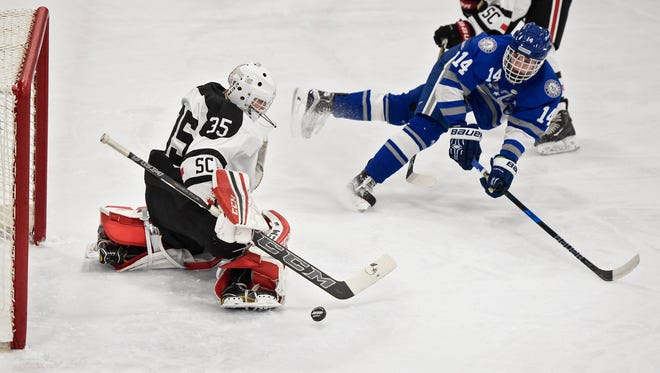 St. Cloud goaltender Soren Falloon blocks a shot by Joe Klang of Brainerd during the first period of the Thursday, Dec. 22, game at the MAC in St. Cloud.