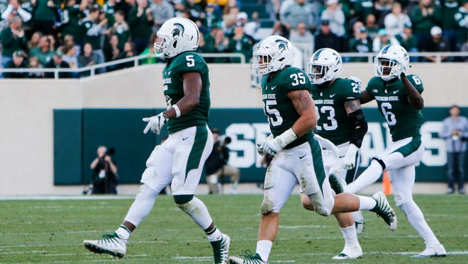 MSU Spartans celebrate a first down against Iowa Saturday, Sept. 30, 2017, at Spartan Stadium in East Lansing.