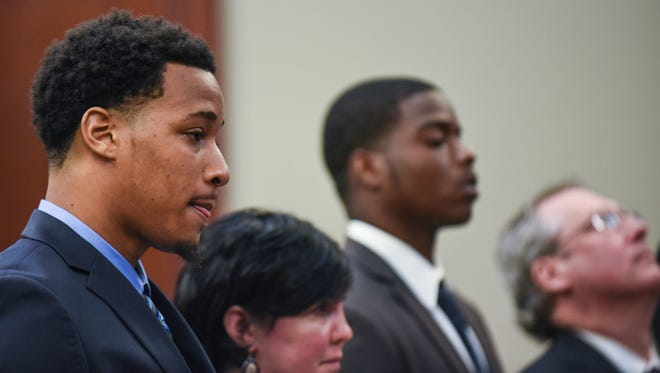From left.  Former MSU football players Demetric Vance and Donnie Corley appear for sentencing in Ingham County Circuit Court Judge Rosemarie Aquilina's courtroom Wednesday, June 6, 2018, with their attorneys Mary Chartier and John Shea, right. They were accused of sexually assaulting a female student during a party at a campus apartment in January 2017.  All three pleaded guilty to lesser charges of seduction as part of an agreement with prosecutors.