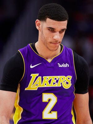 Los Angeles Lakers guard Lonzo Ball reacts during the second half of a game against the Detroit Pistons.