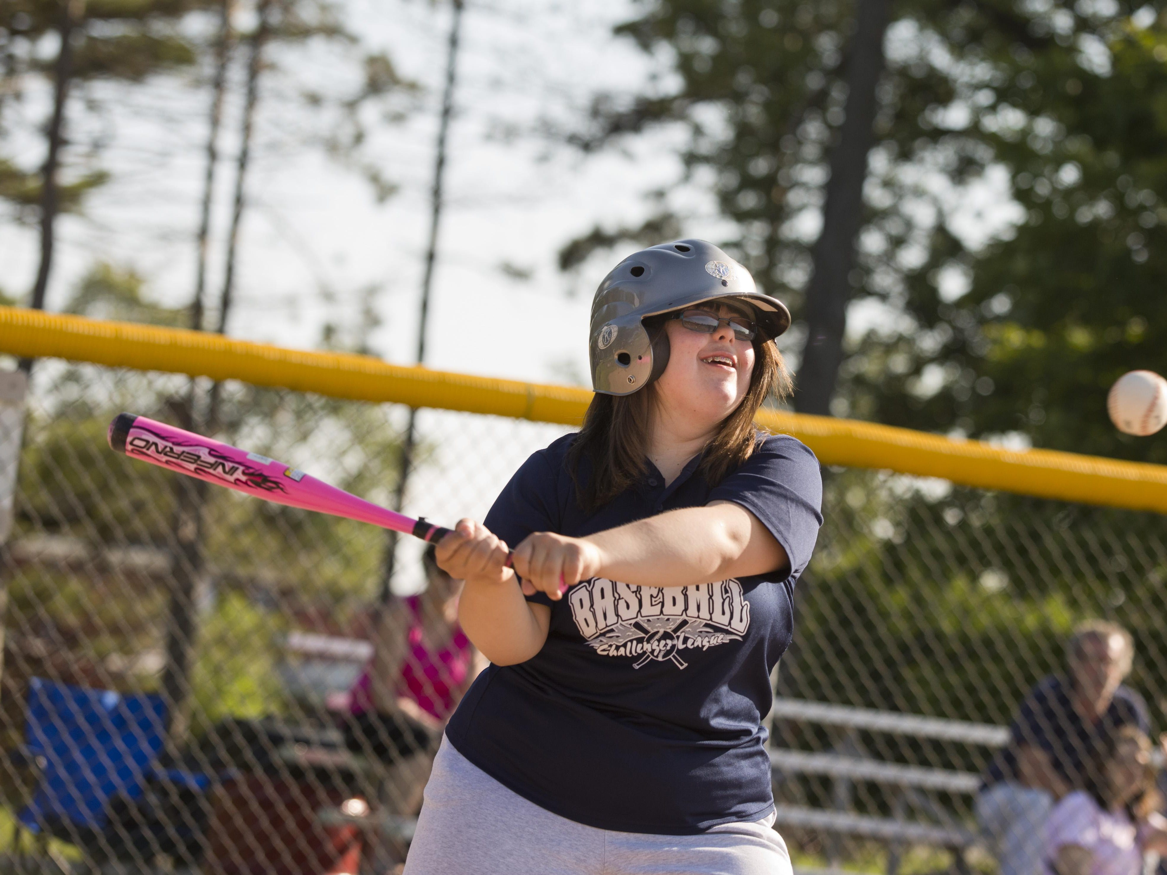 Victoria Guay gets a hit during a Marysville Little League Challenger Division baseball game Thursday, July 2, 2015 at Marysville Municipal Park.