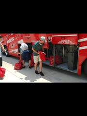 Palm Beach Cardinals players disembark from their bus