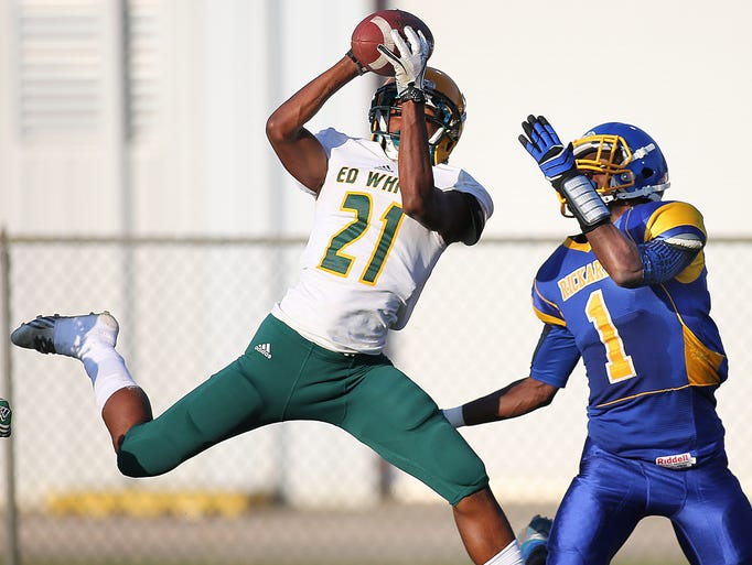 Ed White defender Jadarias Byrd soars to snare an interception from Raider receiver Kalin Riles on Thursday. The Rickards Raiders found the going tough against the Ed White Commanders, falling behind 28-0,  during their first half of action in the Spring Jamboree at Cox Stadium on Thursday, May 22, 2014.