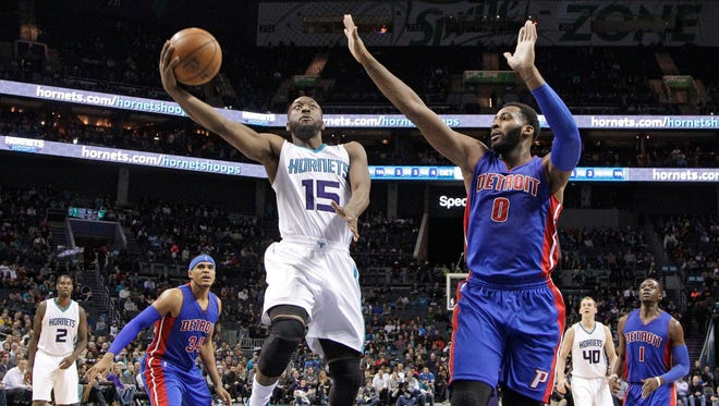 Hornets guard Kemba Walker drives past Pistons center Andre Drummond during the second half in Charlotte, N.C., Wednesday, Dec. 7, 2016.