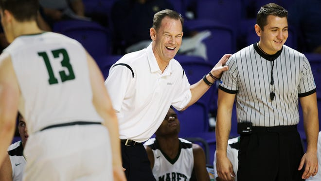 Maret High School coach Chuck Driesell leads his team against Hudson Cathloic during play Friday at the Culligan City of Palms Classic at the Suncoast Credit Union Arena in Fort Myers. Hudson beat Maret 65-51.