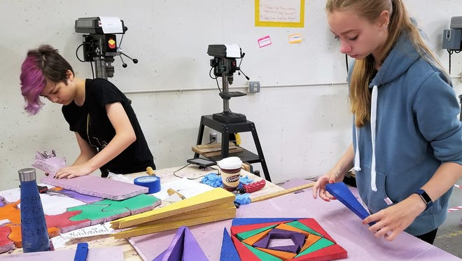 Regan Luck (left) ad Kayla Zimmerman work on their art projects for the art show at Inspiration Studios, West Allis, featuring select student artists' work.