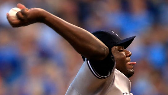 New York Yankees starting pitcher Michael Pineda delivers