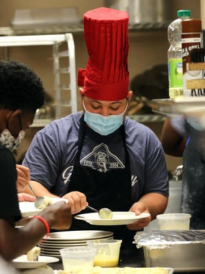 Joel Buff, 17, prepares a plate of scones at culinary camp hosted by Cleveland Community College at the LeGrand Center.