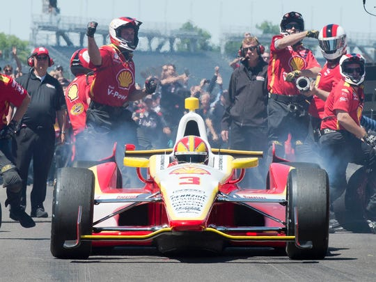 Gary Mook/for the Indianapolis StarHelio Castroneves squeals out of his pit box as his crew celebrates winning the Pit Stop Challenge for a record sixth time at the Indianapolis Motor Speedway, 5/24/13.