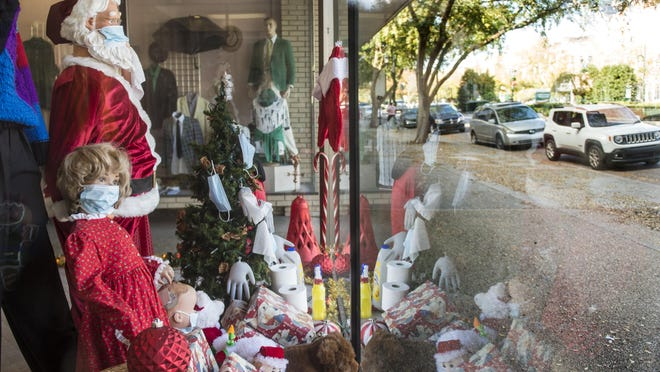 The Christmas and COVID themed window display at Ruben's Department Store in Augusta, Ga., Tuesday afternoon December 1, 2020.