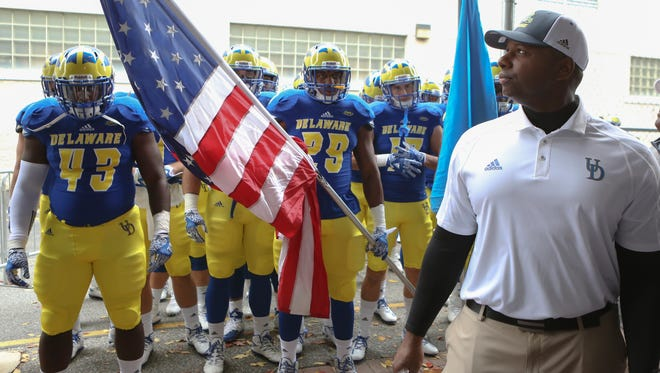 Delaware interim head coach Dennis Dottin-Carter waits to lead his team onto the field before the Blue Hens' 28-3 loss to Stony Brook at Delaware Stadium Saturday.