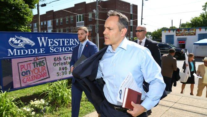 Gov. Matt Bevin arrives at Western Middle School Thursday morning. Hundreds arrived to hear his solution on curbing violence.