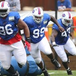 Bills defensive tackle Marcell Dareus (99) gets off the line with Stefan Cahrles (96) and Corbin Bryant (97) during training camp.