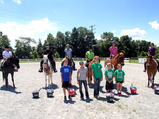 4-H Horse Club members and family members standing, front row, from left, are: Kaleb Repp, Alexandria Little, Sylvia Glassmann, Morgan Hoover, Brock Cooper and Charlotte Forman; and on horseback: Alexandra Schultz, Emma Fetter, Hope Null, Brooke Cooper, Kaitlin Repp and Faith Null.