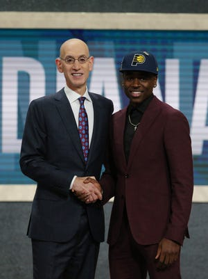 Jun 21, 2018; Brooklyn, NY, USA;  Aaron Holiday (UCLA) greets NBA commissioner Adam Silver after being selected as the number twenty-three overall pick to the Indiana Pacers in the first round of the 2018 NBA Draft at the Barclays Center. Mandatory Credit: Brad Penner-USA TODAY Sports