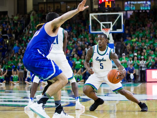 Florida Gulf Coast University redshirt sophomore, Zach Johnson, dribbles down the court during the men's basketball home opener at Alico Arena in Fort Myers on Wednesday, November 16, 2016. Florida Gulf Coast University won the game against University of Texas at Arlington, 85 to 72.