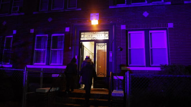 Neighbors standing around outside of 349 Fair St c/s E 18th St in Paterson where it was reported that a person was shot in the head. According to a police officer, it was a self inflicted.  A neighbor who lives next door said she heard a gun shot around 4.36 pm at Apt. 7 on the second floor and  a young man was rushed to the hospital. Mitsu Yasukawa/ Staff Photographer
