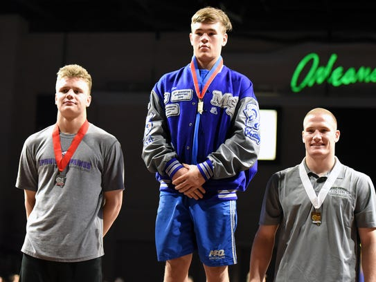 State champion Joe Miller of McQueen, center, is flanked