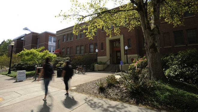 Oregon State University students walk past the Student Health Services building.