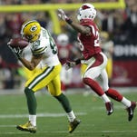 Packers receiver Jeff Janis pulls in a pass on fourth-and-20 late in the fourth quarter against the Arizona Cardinals' Justin Bethel.