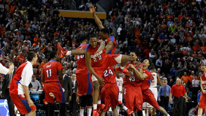 The Dayton Flyers celebrate after beating Ohio State.
