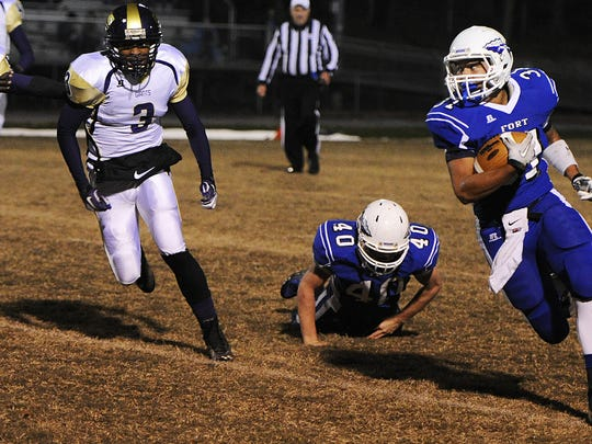 Fort Defiance's Esteban Ruiz-Haynes runs the ball down the field during a football game on Friday, Oct. 25, 2013, at Fort Defiance.