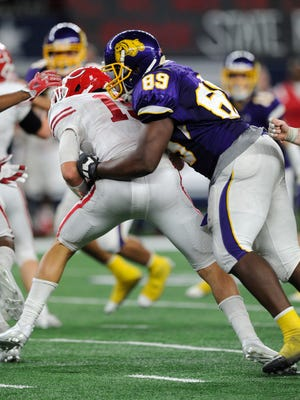 Wylie defensive end Dion Novil (89) tackles Carthage quarterback Kason Davis (19) for a loss during the fourth quarter of Wylie's 31-17 loss in the Class 4A Div. I state championship game on Friday, Dec. 16, 2016, at AT&T Stadium in Arlington.