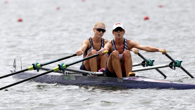 Devery Karz, and Kathleen Bertko, of United States, row to shore after competing in the women's rowing lightweight double sculls heat during the 2016 Summer Olympics in Rio de Janeiro, Brazil, Monday, Aug. 8, 2016.