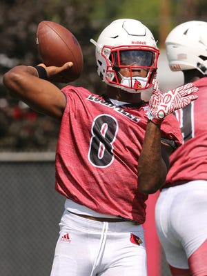 U of L QB LamarJackson (8) passes during practice at the practice field outside Papa Johns Cardinal Stadium.July 31, 2017