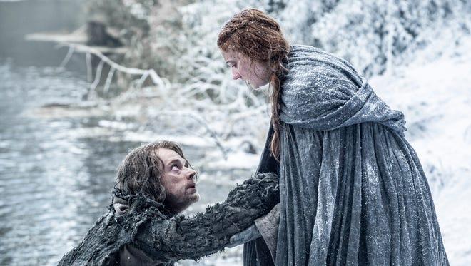 Sophie Turner as Sansa Stark and Alfie Allen as Theon Greyjoy in 'Game of Thrones.'