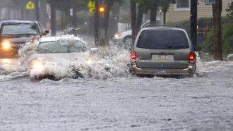 Motorist drive through flooded area of Bangs Ave.  in  Asbury Park,NJ. Tuesday, July 17, 2018. Noah K. Murray-Correspondent Asbury Park Press