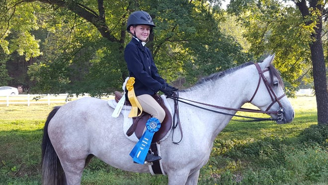 Nova Rowgowski—showing in her very first horse show at Legends Equestrian Center in DecaturSept.11 — won first, third and fourth places in the Walk Trot Hunter Division. She is pictured on her registered Welsh pony, Pretty in Pink.