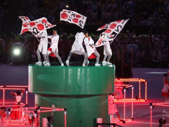 Performers dance as an introduction to the Tokyo 2020 Summer Olympic Games during the closing ceremonies for the Rio 2016 Summer Olympic Games on Aug. 21 at Maracana Stadium in Rio de Janeiro, Brazil.