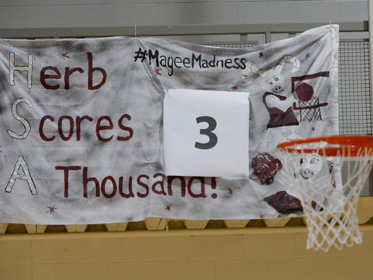 A banner hangs in the basketball court at Philadelphia