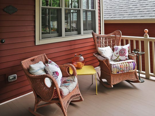 Mark and Candace Burger added Victorian accents to their porches and then filled the spaces with comfortable furnishings.