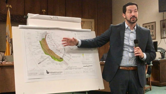 Jonathan Gerardo of Boswell Engineering explains a $2 million fix for a slope collapse in Grace Lord Park to Boonton residents on Sept. 18.
