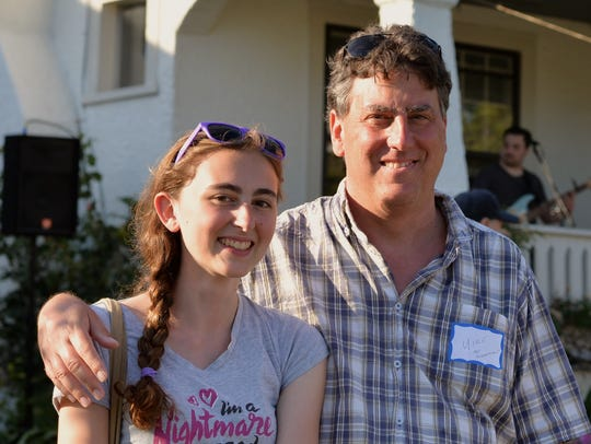 Mike Rhode of Arlington, Va., shown with his daughter