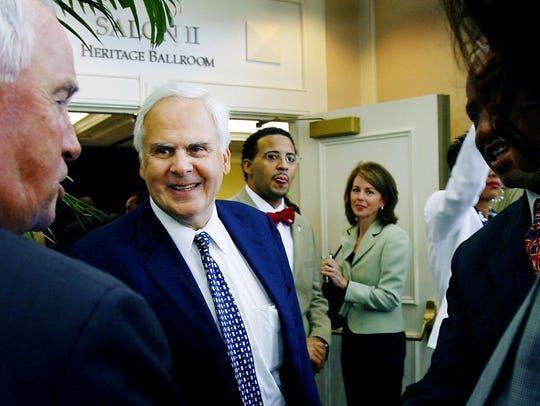 FedEx founder Fred Smith, middle left, shown here in 2006, is backing Republican Senate candidate Marsha Blackburn.