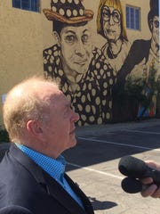 Pat McMahon stands outside First Studio in downtown Phoenix on Wednesday, following a news conference giving details about the Wallace and Ladmo foundation