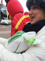 Laura Bowe of Colchester parades with a gift turkey in downtown Burlington on Saturday as part of a fundraiser for the Chittenden Emergency Food Shelf and the Burlington Sunrise Rotary club.