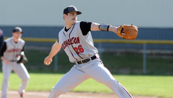 Coshocton's Talon Babcock delivers a pitch during a