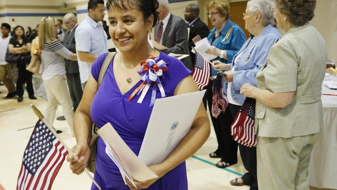 Rafaela Santoyo is all smiles following naturalization ceremonies Friday, September 4, 2015, at Burtsfield School in West Lafayette. Santoyo, who is originally from Mexico, is the first naturalized client assisted by the LUM Immigration Clinic. Nearly 100 people were sworn in as U.S. citizens at the event.
