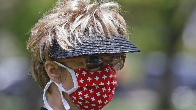 Communities across Ohio are now requiring the wearing of a face mask inside buildings and in crowds outside.