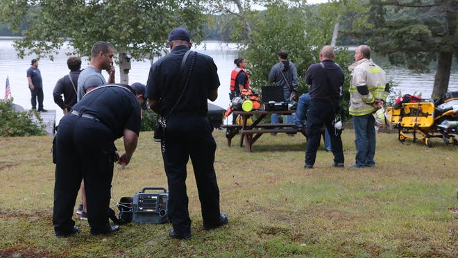 Divers recover the body of a boater Friday morning from Dark Brook Reservoir.