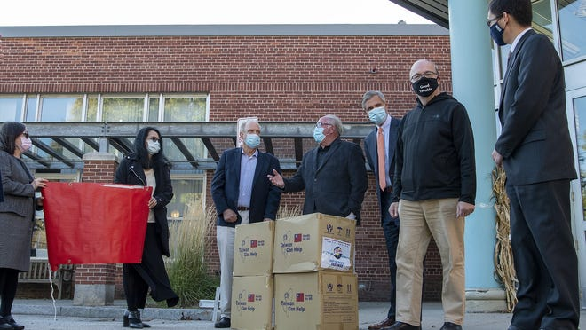 WORCESTER - Local officials on Friday gather at the Worcester Senior Center on Providence Street to accept a donation of 10,000 face masks from the Taiwan Chamber of Commerce of New England. They are, Sandra Lai, left, and Patricia Harris from the Chamber; Worcester Mayor Joseph M. Petty; State Rep. James J. O'Day; State Rep. John J. Mahoney; Congressman James P. McGovern; and Jonathan Sun, Director-General of the Taiwan Chamber of Commerce of New England.